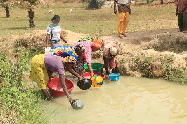 Women fetching water from the only water source in the community (PHOTO: AMCOW/atayibabs)